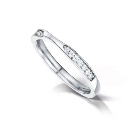 Shaped court eternity/wedding ring with channel set 2 sections. Platinum. 2.6mm x 1.7mm